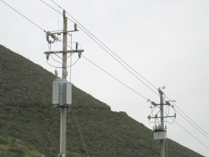 Electric pole with transformer